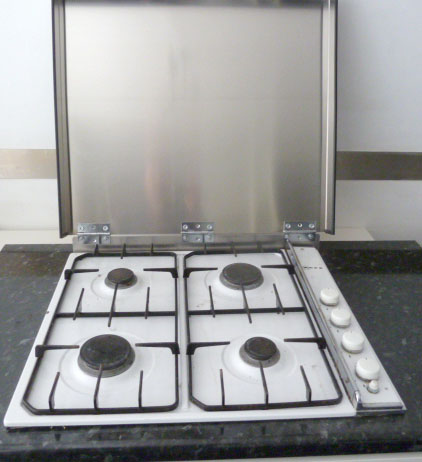 Hinged glass hob cover